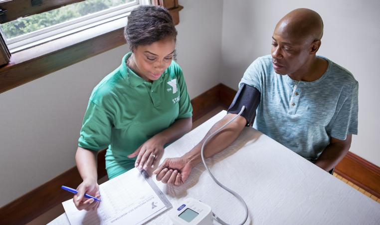 Two people tracking blood pressure.